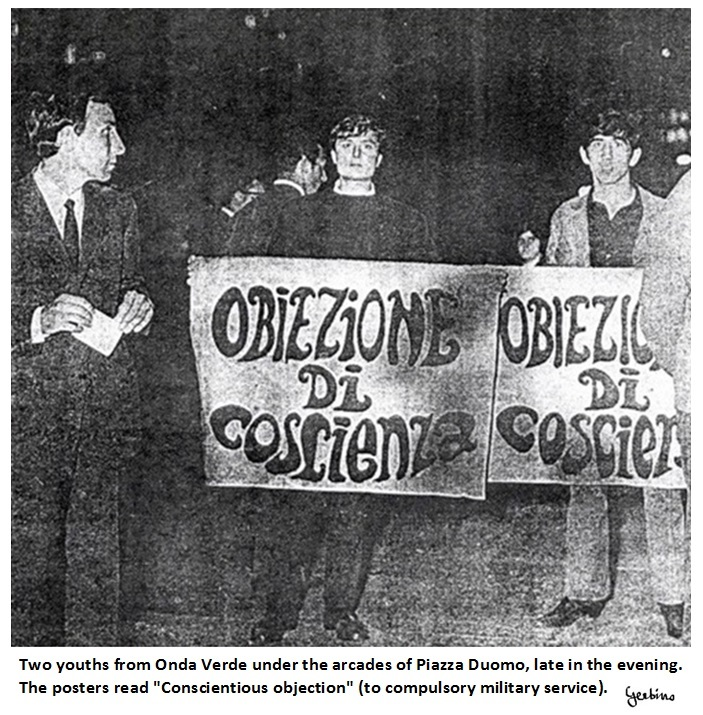 The posters read 'Conscientious objection' (to compulsory military service)
